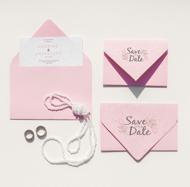 Flat lay wedding ideas with set of envelopes with rings