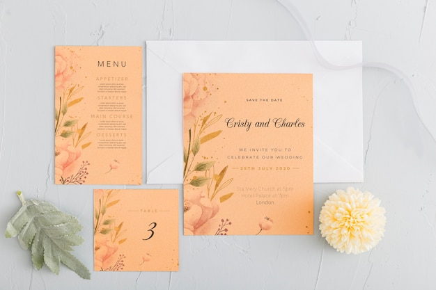 Flat lay wedding invitation with flowers