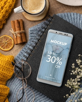 Flat lay winter hygge arrangement with phone mock-up