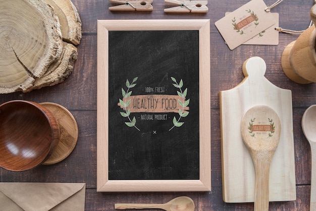 Flat lay of wooden dishes with blackboard