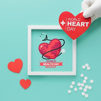 Flat lay world health day mock-up and heart
