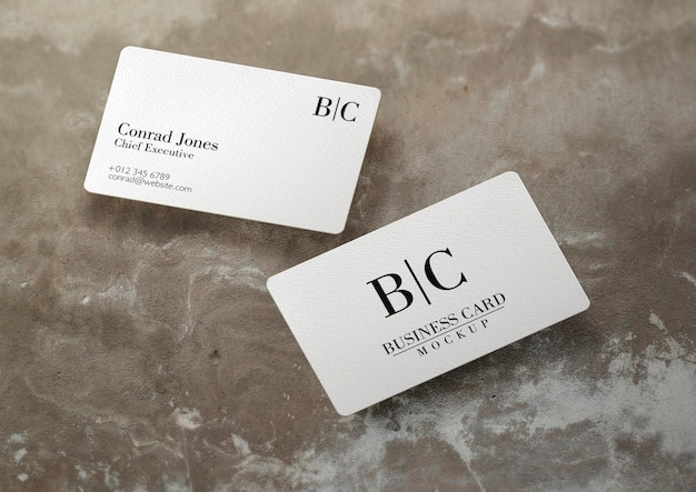 Floating business card over concrete surface mockup