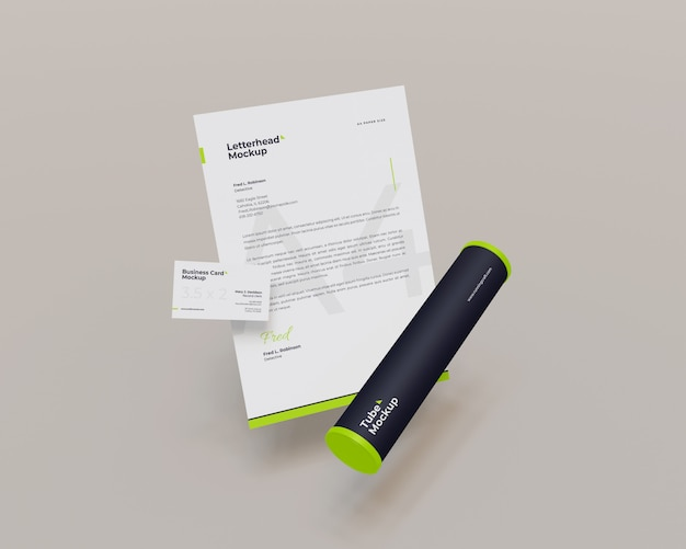 Floating letterhead and business card with tube mockup looks the front view