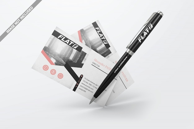 Floating pen with business cards mockup