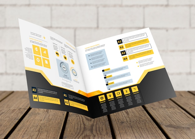 Modello di brochure quadrato galleggiante sopra la superficie in legno