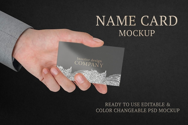 Floral business card mockup psd with businessman's hand