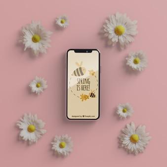 電話のモックアップと花のフレーム