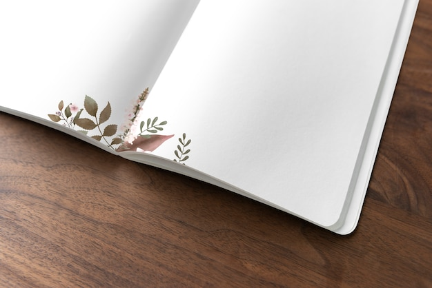 Floral notebook mockup on a wooden table