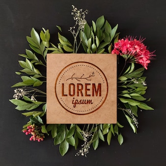 Floral wooden engraved logo mockup with natural frame
