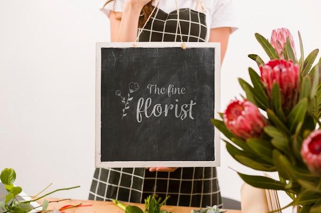 Florist holding mock-up sign