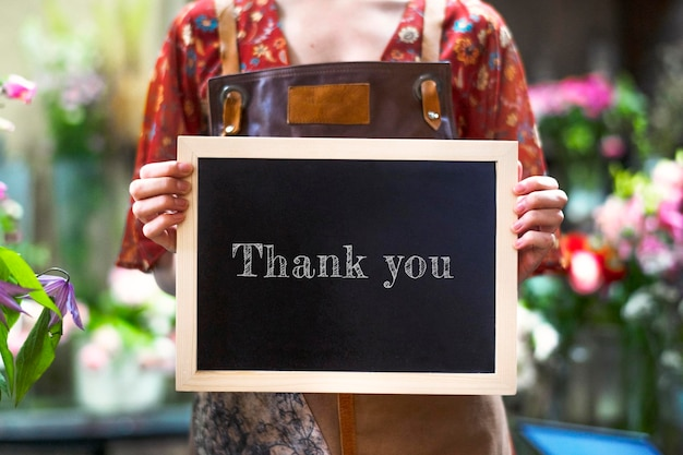 Florist holding a thank you board sign mockup