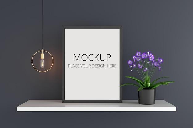 フレームモックアップと花とランプ