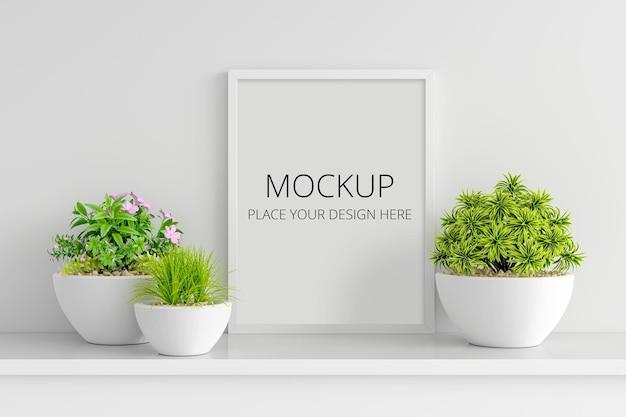 額縁のモックアップと花と多肉植物