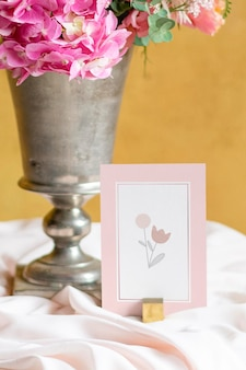 Flower vase by a card mockup