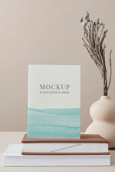 Flyer on books psd mockup ombre blue watercolor