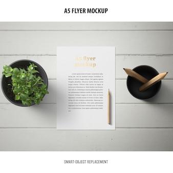 Flyer mockup in a desktop