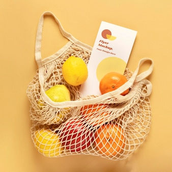 Flyer  in a reusable net bag with fruits