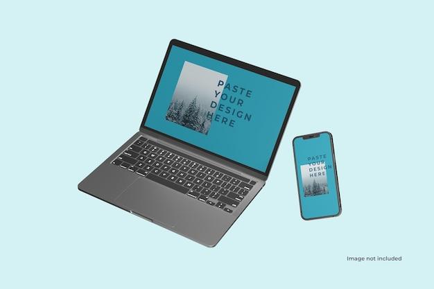フライングノートパソコンとスマートフォンのモックアップ