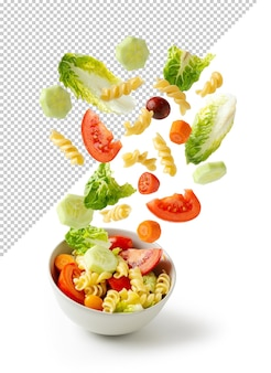 Flying pasta salad in a bowl, isolated with clipping path