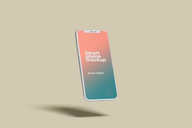 飛んでいる白いスマートフォンのモックアップ側面図