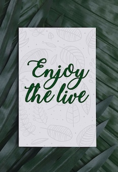 Foliage with motivational message on card
