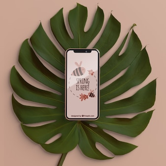 Foliage with phone on top concept