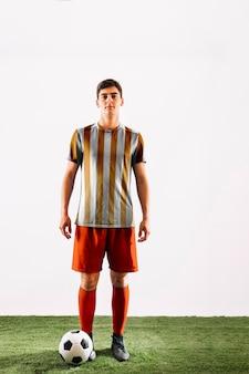 Football player posing