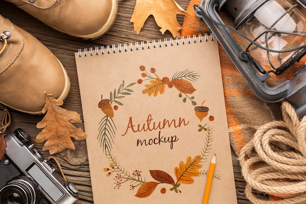 Frame of autumn objects and notebook