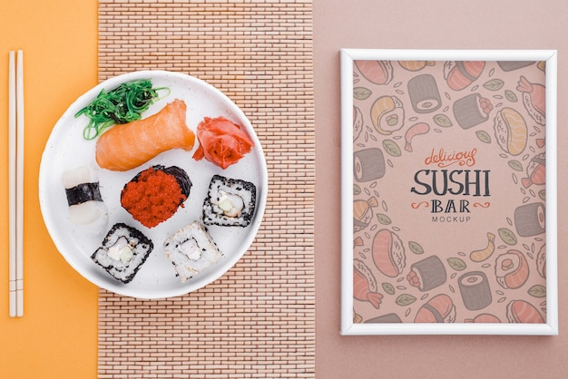 Frame beside plate with sushi rolls on table