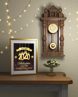 Frame beside watch on wall with new year theme