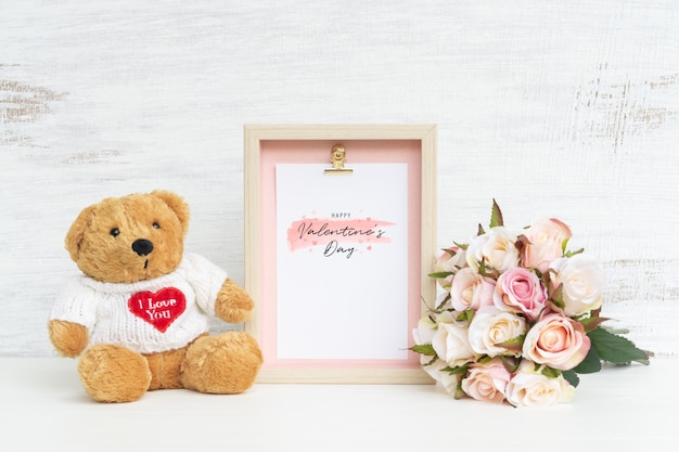 Frame and cute bear with bouquet of pink roses mockup