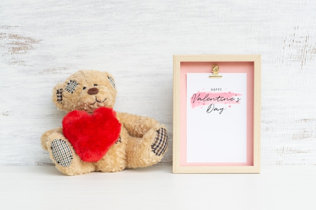 Frame and cute bear with red heart mockup