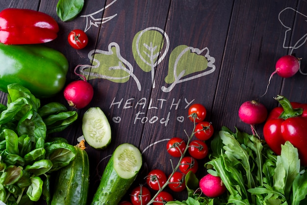 Frame of different health vegetables on a wooden background