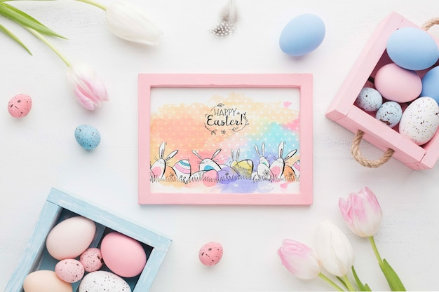 Frame of flowers and painted eggs
