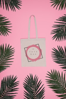 Frame of leaves with tote bag in center