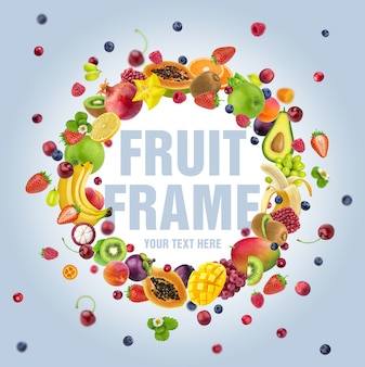 Frame made of different flying fruits and berries, with copy space