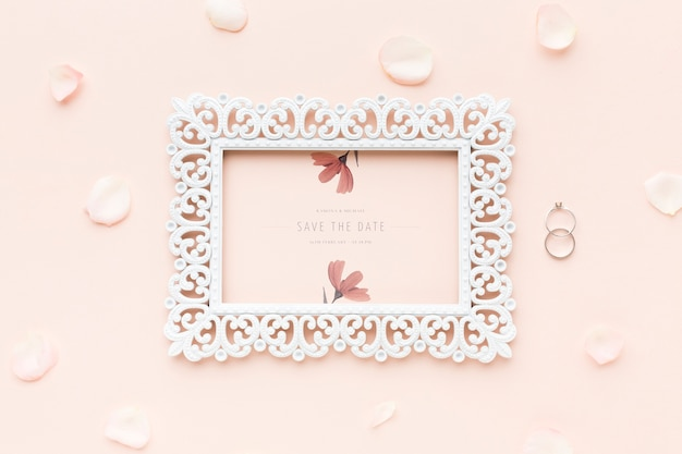 Frame mock-up and wedding rings with flowers