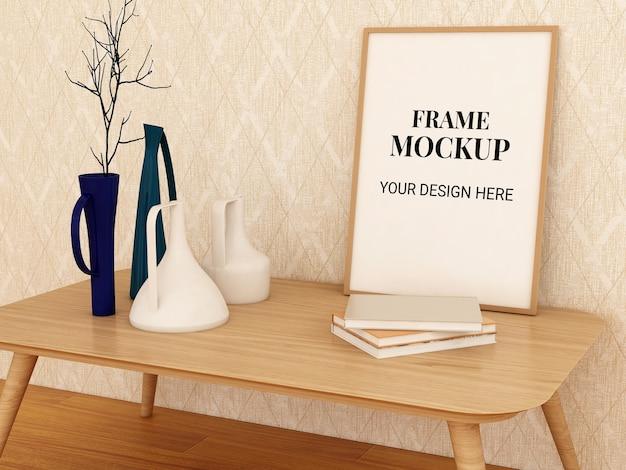 飾りと本と机の上のフレームモックアップ