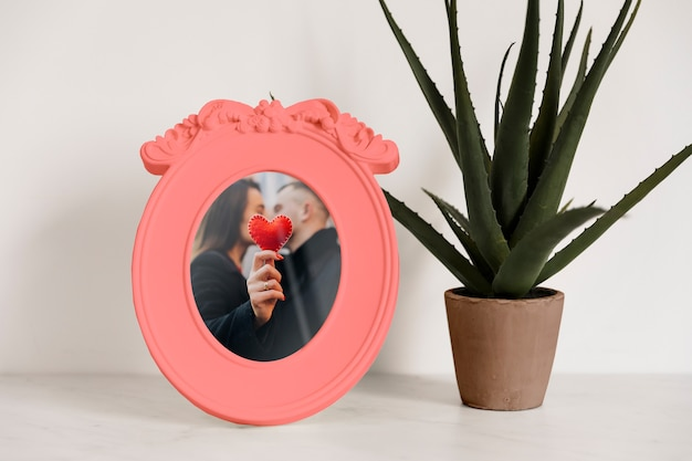 Frame mockup next to a plant