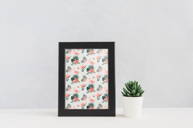 Frame mockup next to plants