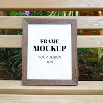 Frame mockup realistic on the park bench