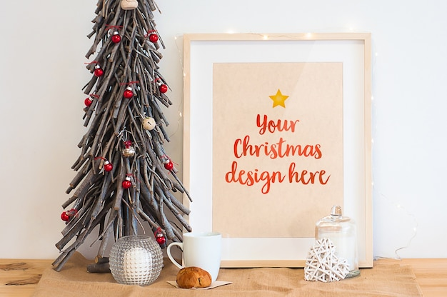Frame mockup surrounded by christmas decoration