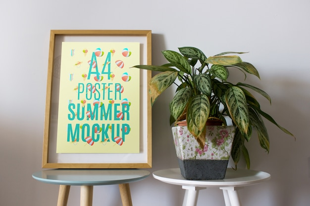 Frame mockup on table with plant