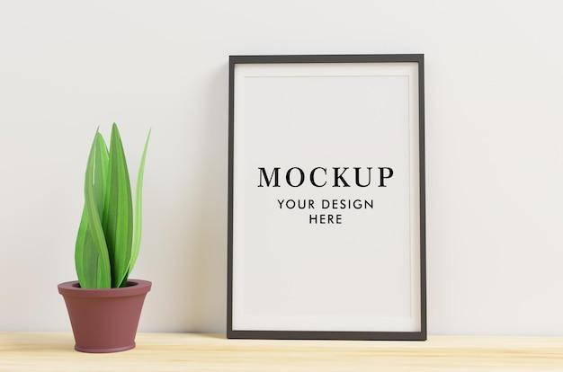 Frame mockup with decorative plant