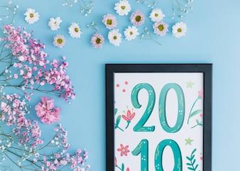 Frame mockup with floral decoration