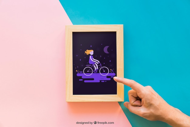 Frame mockup with pointing finger
