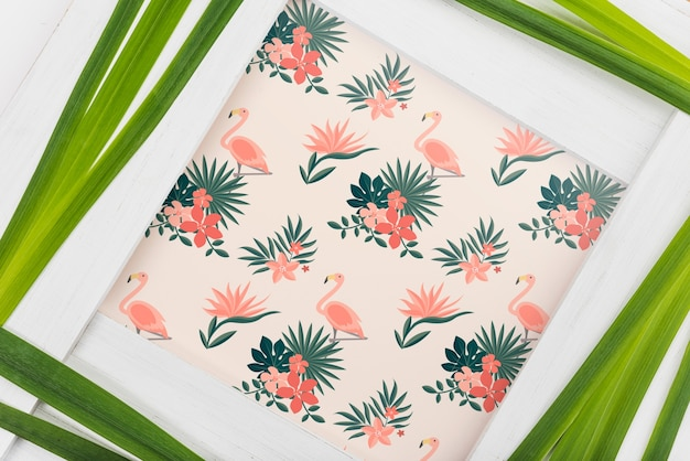 Frame mockup with tropical leaves