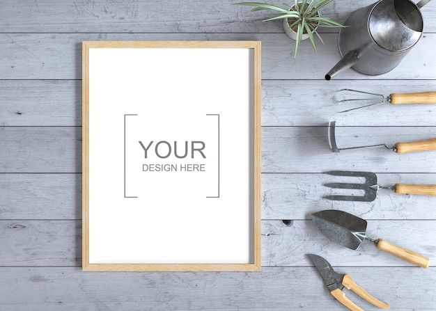 Frame mockup on wooden table with gardening tools
