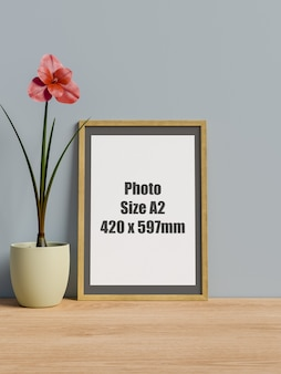 Frame on table with flower