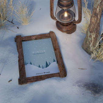 Frame on snow beside lantern